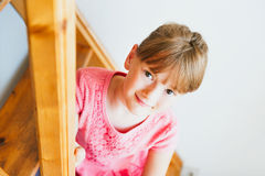 Little girl sitting on stairs Stock Image