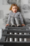 Little girl sitting on a stairs Royalty Free Stock Image