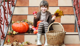 Little girl sitting on stairs outdoors Stock Image
