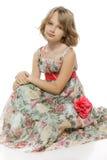 Little girl sitting on the studio floor Royalty Free Stock Images