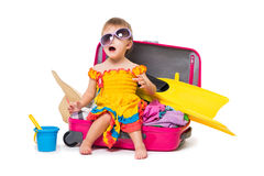 Little girl sitting on a suitcase Royalty Free Stock Photography
