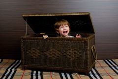 Little girl sitting in suitcase Royalty Free Stock Photography