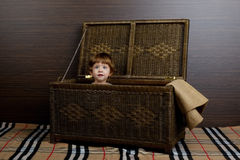 Little girl sitting in suitcase Stock Images