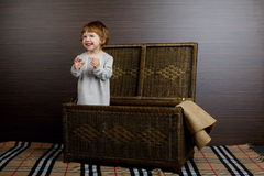 Little girl sitting in suitcase Royalty Free Stock Photo