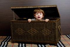 Little girl sitting in suitcase Royalty Free Stock Photos