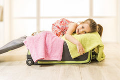 Little girl sitting in a suitcase, ready for travel Stock Photo