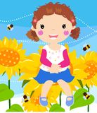 Little girl sitting on sunflower Stock Image