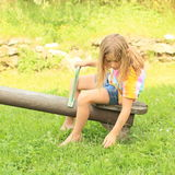 Little girl sitting on a swing Royalty Free Stock Images