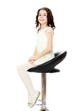 Little girl sitting in a swivel chair. Stock Image