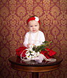 Little girl sitting on the table Royalty Free Stock Photos