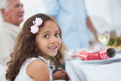 Little girl sitting at table for christmas dinner Stock Photos