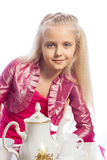 Little girl sitting at the table Stock Image