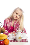 Little girl sitting at the table Royalty Free Stock Photos