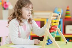 Girl learning to use abacus Royalty Free Stock Photo