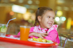 Little girl sitting at table Royalty Free Stock Image