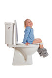 Little girl is sitting on toilet Stock Photography