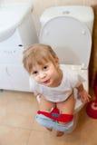 Little girl sitting on   toilet Royalty Free Stock Image