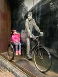 Little girl sitting on a vitage bicyle