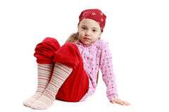 Little girl sitting on the white backround Royalty Free Stock Photo