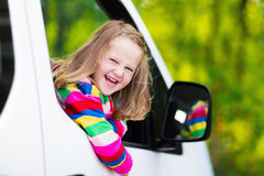 Little girl sitting in white car Royalty Free Stock Photo