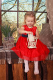 Little girl sitting by the window Royalty Free Stock Photography