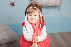 Little girl sitting in wooden toy plane Royalty Free Stock Photography