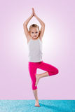 Little girl sitting in yoga pose Royalty Free Stock Image