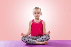 Little girl sitting in yoga pose Stock Image