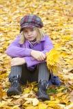 Little girl sittingin the park Royalty Free Stock Photos