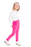 Little girl six years in pink jeans Stock Image