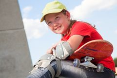 Little  girl with  skateboard Stock Photos