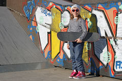 Little girl with skateboard in skate park Royalty Free Stock Images