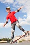 Little girl -  skateboarder Royalty Free Stock Images