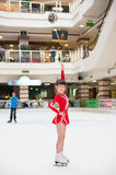 Little girl skates figure skating victory sports suit Stock Photo