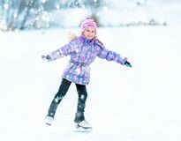 Little girl skating Stock Images