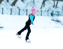 Little girl skating Royalty Free Stock Photo