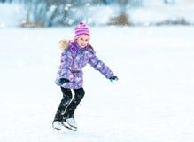 Little girl skating Stock Photos