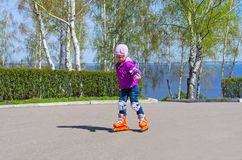 Little girl skating on roller skates Stock Photography