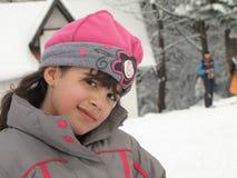 Little girl in ski suit Stock Photos