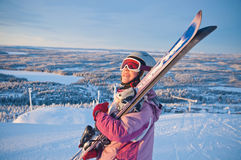 Little girl-skier on the hill watching the sunrise Royalty Free Stock Photos