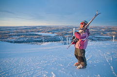 Little girl-skier on the hill watching the sunrise Stock Photography