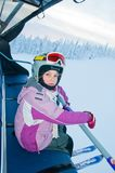 Little girl-skier on the ski lift Royalty Free Stock Photo