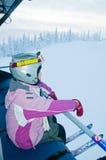Little girl-skier on the ski lift Royalty Free Stock Image