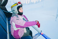 Little girl-skier on the ski lift Royalty Free Stock Images