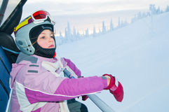Little girl-skier on the ski lift Stock Photography