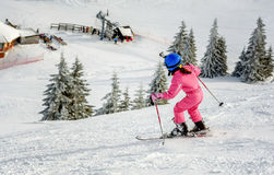 Little girl skiing fast downhill Stock Image