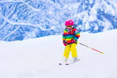 Little girl skiing in the mountains Stock Image
