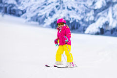 Little girl skiing in the mountains Royalty Free Stock Images