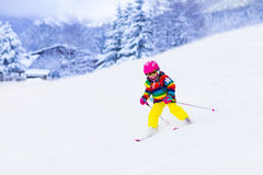 Little girl skiing in the mountains Stock Photography