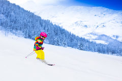 Little girl skiing in the mountains Stock Images
